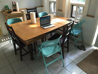 Big kitchen table including chairs