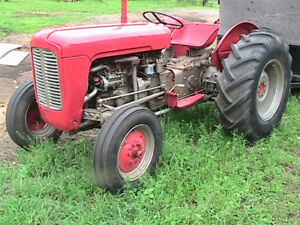 MF and Int. tractors and MH manure spreader