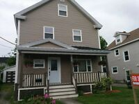 2 1/2 storey home with a detached garage for sale