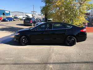 Black 2016 Ford Fusion SE Sedan with under 5000Kms