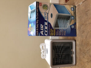 Portable air conditioner/ humidifier