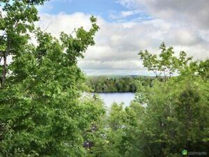Splendide propriété au bord d'un lac à vendre en Mauricie