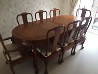 Solid Rosewood dining table and 8 chairs