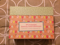 Assortment of greeting cards and envelopes
