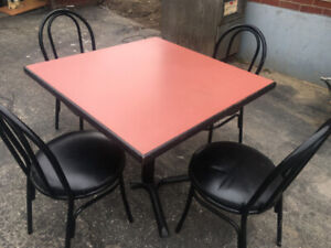 A SET OF RESTAURANT TABLE AND CHAIRS