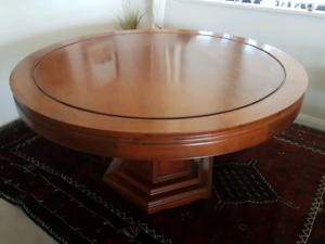 Antique Chinese round dining table with 8 chairs and 2 bab