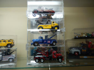 collection of tow truck never played with