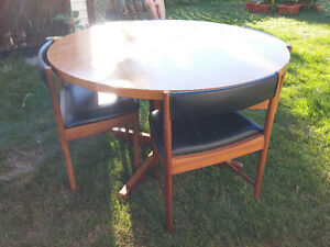 teak set of 4 tuck away chairs and round teak dining table