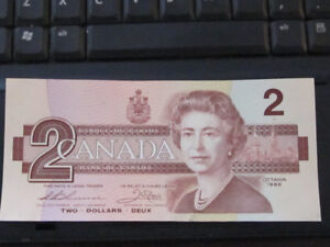 Canadian 1.00  and 2.00 Bills in Very Good Condition