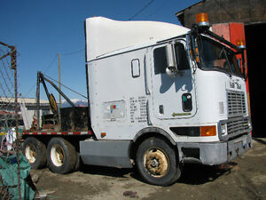 International Cabover mobile home moving truck