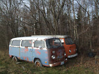 VW bus and various antique car body parts,