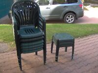 6 green plastic patio chairs and 3 small tables