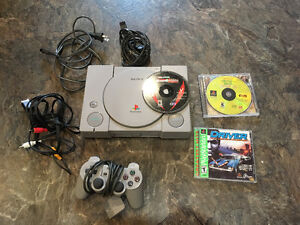 PlayStation 1 - PS1 Console and 3 games.