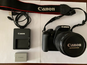 Canon EOS Rebel XS DSLR Camera With EF-S 18-55mm IS Lens