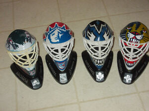 4 MINIATURE NHL GOALIE  MASKS / HELMETS !!