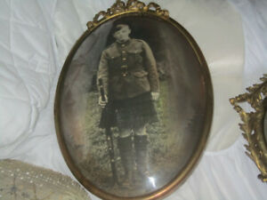 antique brass frame with military person