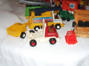 A Collection of Fisher Price Toy Trucks