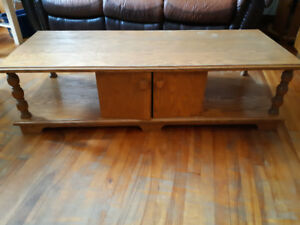 Solid oak coffee table with matching storage table.