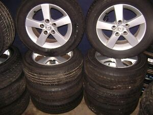 ! ALMOST NEW MAZDA 3 ALL SEASON WHEEL SET !