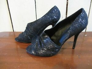 Size 8 Black High heel l with Silvery tones