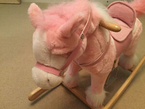 Pink plush ride on rocking horse makes horse sounds