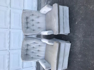 Two comfortable swivel rocking chairs