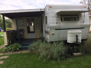 29' Fleetwood Wilderness trailer with add a room and golf cart..