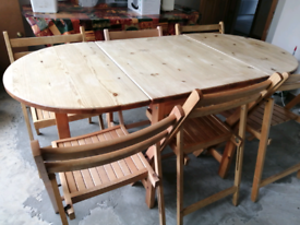 Solid pine dining/kitchen table and 6 chairs