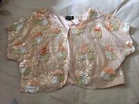 Beautiful embellished cropped short sleeved jacket