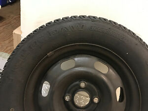 Set of four snow tires on rims
