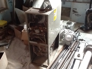 Used mid-efficient furnace for sale + chimney & gas piping.
