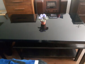 Black, glass, dining room table about 5' X 3', accepting offers