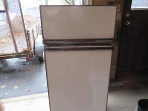Propane  apartment size fridge for sale.