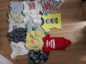 140+ Baby clothes mostly 3-6 months, books, etc. Sold in bundle.