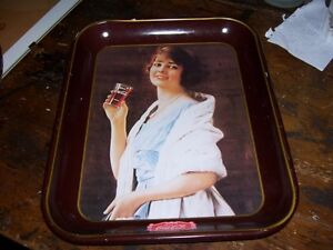 Lady holding glass Drink Coca Cola Tray