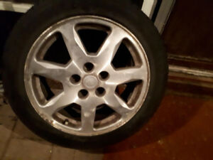 Cadillac rims and tires P225/50/R17