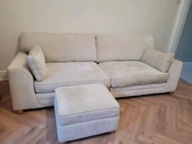 Cream fabric sofa with a storage footstool