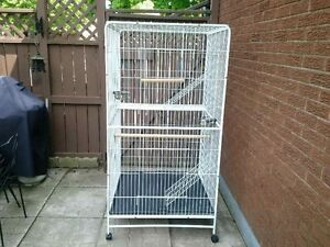 AE LARGE PARROT CAGE, WITH ACCESS. IN VERY GOOD CONDITION