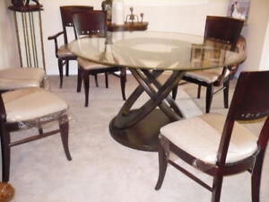 5ft. glass round table with 5 chrs,,,,sits 8
