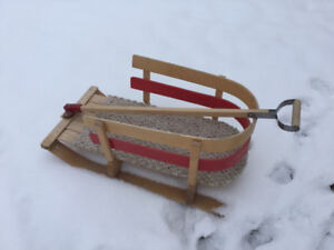 Toddler sleigh with sides rails.