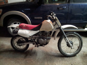 .....WANTED 1998 HONDA XR100R REAR WHEEL COMPLETE
