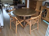 Wooden table and 5 fold away IKEA chairs