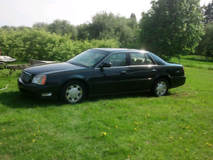 2000 deville trade for boat or quad