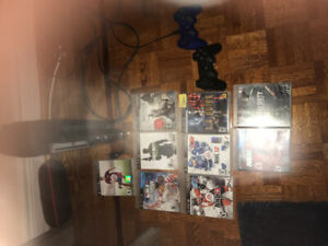 PS3 WITH 7 GAMES! and Two controller