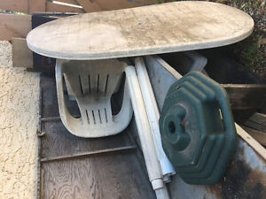 Table, chairs, umbrella stand