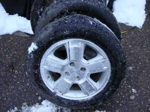4-195 60 r15 directional snow tires on 4x100 alum wheels 95%