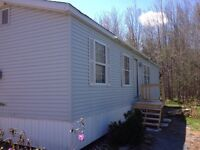 Attractive 2 bedroom mini on large very private acre lot