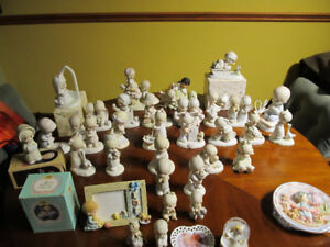 Collection of Precious Moments figurines.