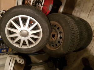 4 Winter Tires on Steel Rims with hub caps - 225/60R16 102T XL