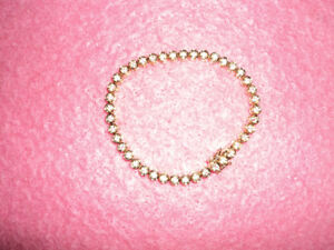 Crystal and gold...reduced Tennis Bracelet